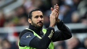 Newcastle United's Jonas Gutierrez  gestures to the fans as he warms up during their English Premier League soccer match between Newcastle United and Manchester United at St James' Park, Newcastle, England, Wednesday, March, 4, 2015. Jonas Gutierrez returned to the Newcastle team last week after being given the all-clear from testicular cancer in November 2014. (AP Photo/Scott Heppell)